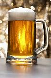 Beer mug in front of a glittering background