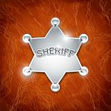 sheriff's metallic badge as star on leather texture