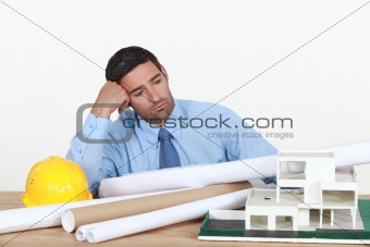 A bored architect at his desk.