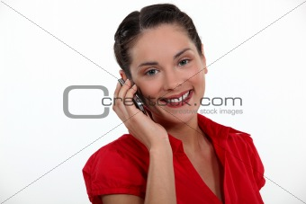 Woman making call on mobile telephone