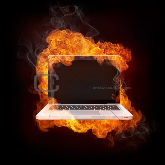 Laptop in Fire isolated on black Bacground.
