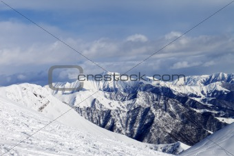 Ski slope and snowy mountains