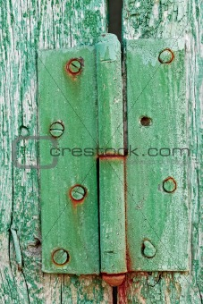 Old hinges on the wooden boards