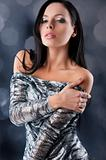 sensual brunette with fashion silver dress in sensal position