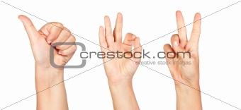 Three hands making the sign of Ok