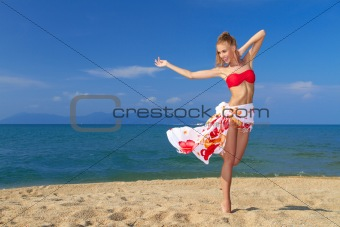 Adorable woman standing at the tropical beach