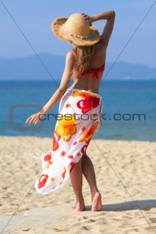 Young sexy woman standing at the beach