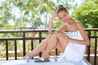 Woman in towel on bathtub