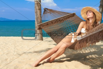 Elegant woman reclining in a hammock