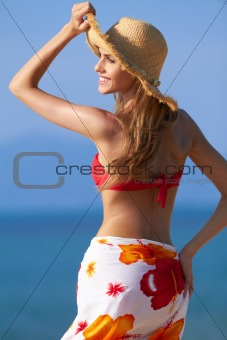 Smiling blonde with hat for sun protection