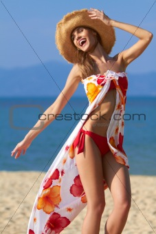 Carefree young woman on the beach