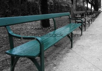 Blue-green bench isolated on black and white background