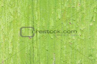 Old green paint on wooden board