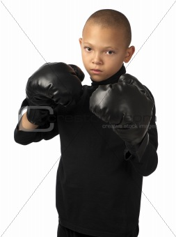 A young boy is ready to fight.