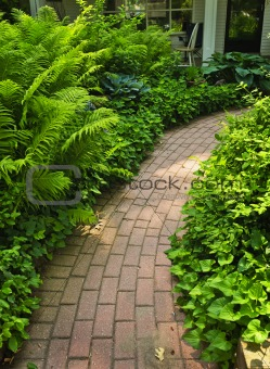 Brick path in landscaped garden