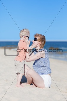 mother and son together at the beach