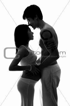 Silhouette of pregnant lady and husband