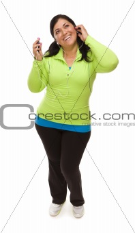 Attractive Middle Aged Hispanic Woman In Workout Clothes with Music Player and Headphones Against a White Background.