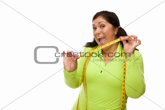 Attractive Middle Aged Hispanic Woman In Workout Clothes Showing off Her Tape Measure Against a White Background.