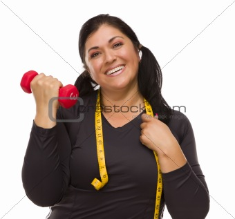 Attractive Hispanic Woman with Tape Measure Lifting Dumbbell Against a White Background.