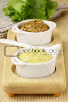 French mustard sauce in white gravy boat