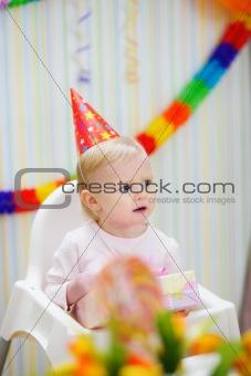 Celebrating birthday baby looking in corner