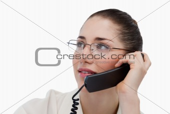 Close up of a secretary making a phone call