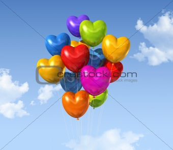 colored heart shape balloons on a blue sky