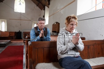 A man and a woman praying