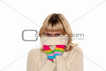 blond girl in Multi-coloured gloves is trying to hide