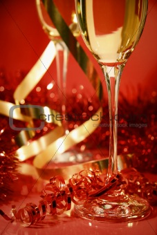 Fluted champagne glasses and ribbons