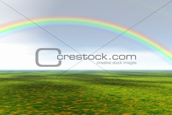 Green field with rainbow