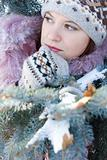 Beautiful girl in hat and mittens