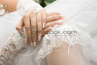 Bridal manicure and garter