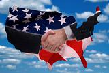 USA map outline with handshake and flag