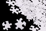 puzzle pieces on black
