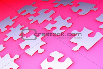 Puzzle pieces on red