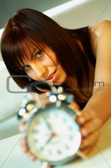 brunette with clock