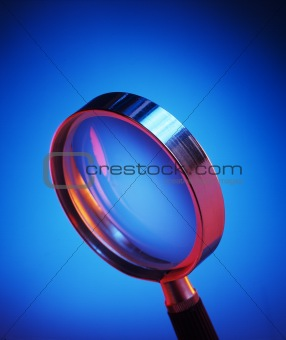 Magnifying glass on blue