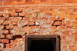 brick wall with black hole
