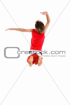 Boy jumping arms in grande pose.