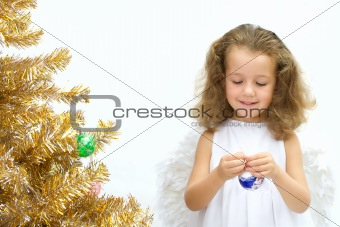 Angel decorating a christmas tree