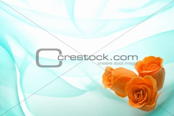 Decorative orange buds of a rose from soap
