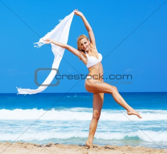 Dancing happy girl on the beach