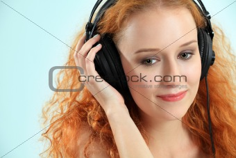 Beautiful young redhead with headphones