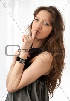 Beautiful woman making silence sign