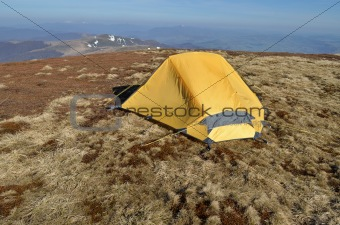 Dawn in the mountains and yellow tent