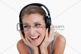 Close up of a smiling woman listening to music