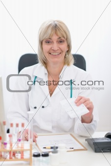 Middle age doctor woman giving prescription