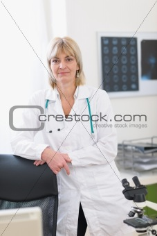 Portrait of middle age doctor woman at laboratory